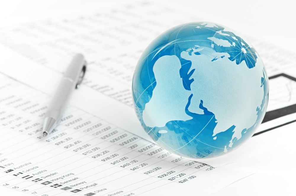 An image of a small glass globe resting on documents